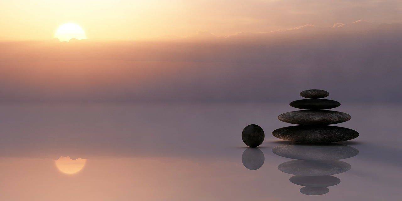 Balanced stones image found on Pixabay by RealWorkHard. https://pixabay.com/images/id-110850/