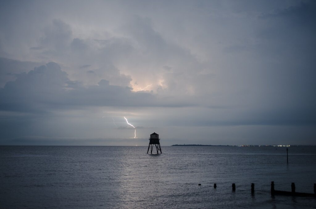 Lighting storm over water, expressing shock of the day and the year